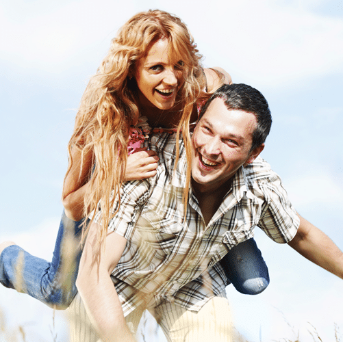 Man giving woman piggyback ride